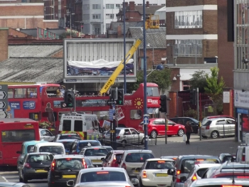Big Brum Buz stuck in traffic in Digbeth - mobile crane