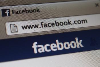 Facebook Logo at Macbook